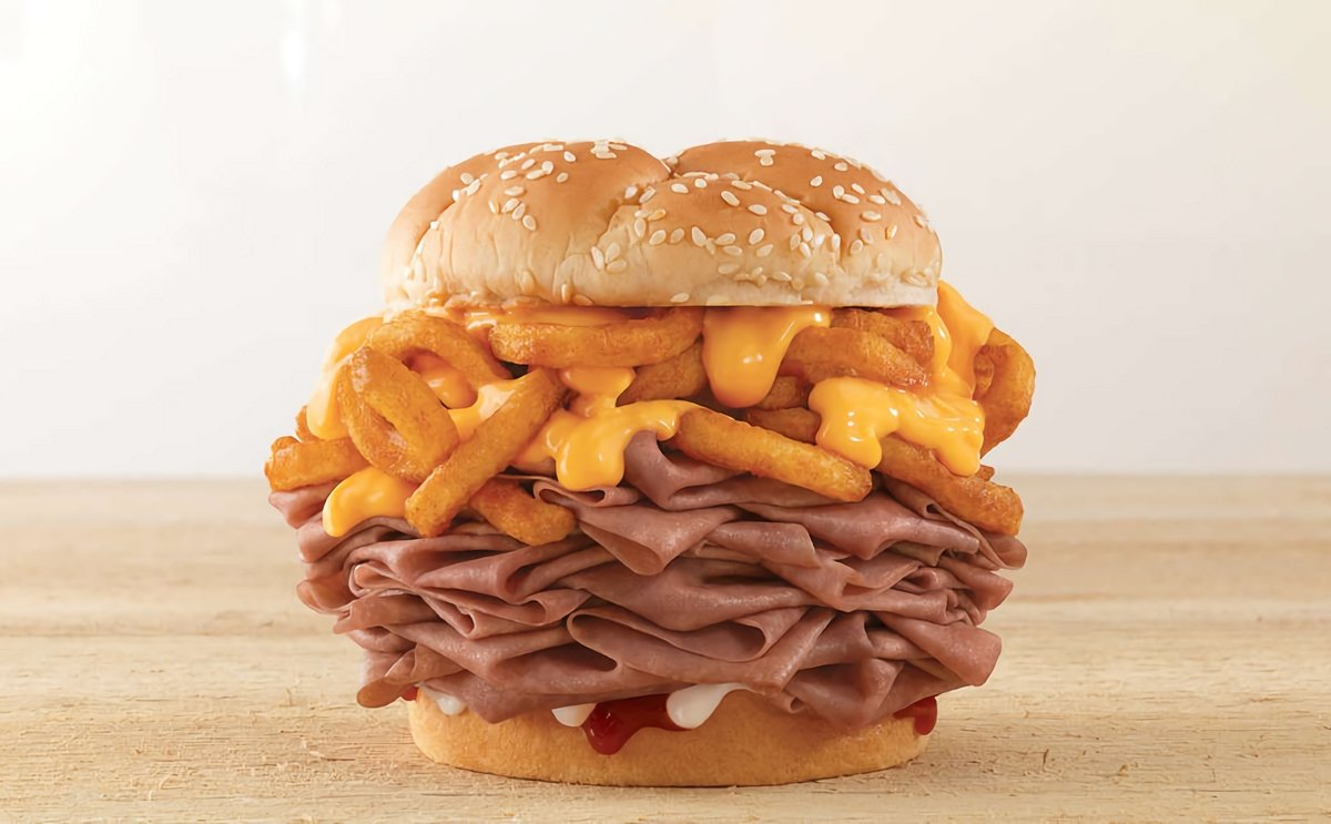 QSR chain Arby`s is testing a massive sandwich stuffed with curly fries: the Arbynator