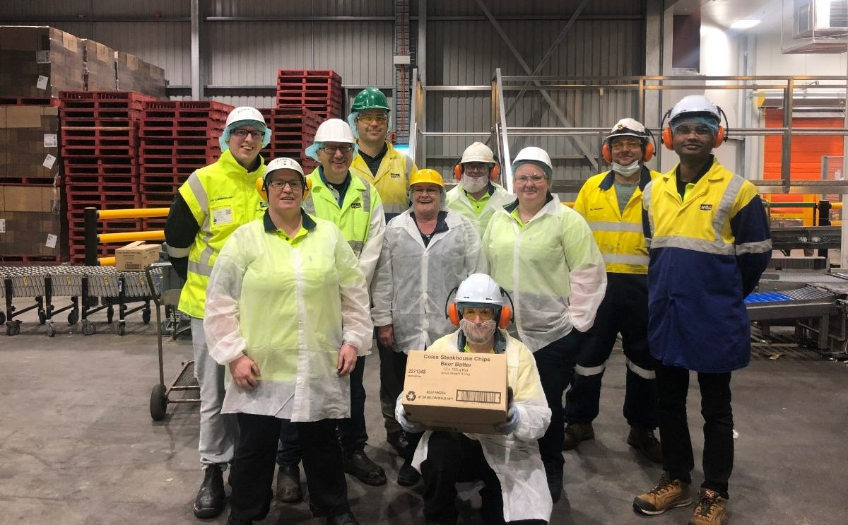 In Tasmania, Australia, McCain Foods has completed the upgrade of its Smithton plant.Staff shows a box of beer battered french fries, that now can be produced on the new batterline and fryer.